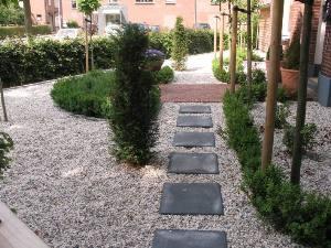 Kosten grind zakken - Tuin ideeen met kiezelstenen ...
